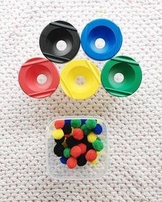 Pom-pom colour matching activity using painting no spill cups, easy no prep activity, great for colour coordinations recognition and practicing fine motor and hand eyed coordination skills.