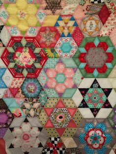 https://flic.kr/p/tn5eY2 | Smitten Quilt Top | Hand stitching together rows of EPP hexagons to complete quilt top