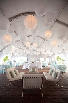 Tent with Chinese lanterns and lounge furniture