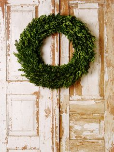 Boxwood wreath. Must learn how to make one of these!