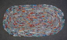 Recycled plastic grocery bags crochet fo blankets and rugs. Given to homeless. Plastic Bag Crafts, Plastic Bag Crochet, Recycled Plastic Bags, Plastic Grocery Bags, Recycled Rugs, Recycled Crafts, Crochet Rug Patterns, Oval Rugs, Throw Rugs