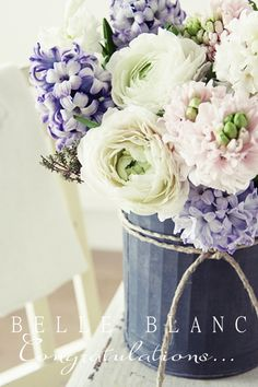 A bouquet of delicate, soft colored flowers.