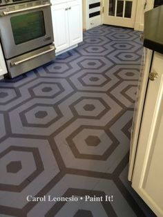 @Carol Leonesio of Paint It!: Reverse stenciled Hexagon floor, using tape as a mask.