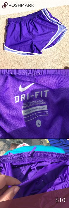 Lilac Purple Nike Dri-Fit Shorts ☀️ This is a pair of purple lilac dri-fit Nike shorts. ☀️ Unfortunately a part of where the inner underwear part connects to the short band has come undone, as shown. Price reflects. Still functional.  ☀️ Price is firm unless bundled! Nike Shorts