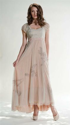 SPRING DANCE DRESS $219.95 Now Only $129.99 Her dance card was full. Embroidery waltzes upon subdued layers of blush and celery. A French hem reveals pretty shoes with extended length in back. Sheer poofy sleeves, high waist, flattering bias-cut skirt and side zip.