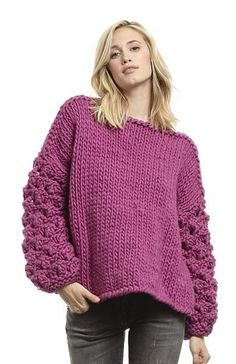"""""""The Kristen"""" is a luxurious, oversized sweater with floral lacework sleeves. This sweater was designed to be effortless and cozy with an open sides and a draped rectangular shape to create movement. Wear in place of a jacket on those days where the cold air begins to set in and pair it with your favorite denim and ankle bootie.  ALL LARGE ITEMS CAN TAKE 7-10 BUSINESS DAYS TO SHIP.         READY WEAR COLLECTION, HAND-KNIT IN BOSTON, MA  MATERIAL:100% WOOL  SIZING & FIT:ONE SIZE FITS MOS..."""