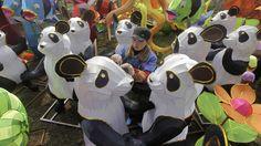 A worker prepares for the Wuhan-Chengdu International Panda Lantern Festival in Wuhan, Hubei province, China.