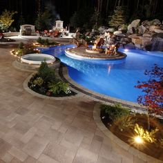 """Love the bridge to the """"island"""" - HATE hot tub - for being """"extravagant"""" the outdoor barbeque is a little lacking - wold have a whole kitchen - very plain fireplace area"""