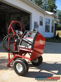Welding Cart by MajSuckelton -- Homemade welding cart adapted from a hand truck. Welder and tank supports were fabricated from scrap steel. http://www.homemadetools.net/homemade-welding-cart-24