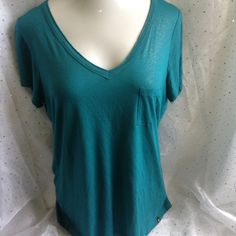 Rock & Republic Teal Sparkle Glitter V-Neck Tee Super soft distressed v-neck glitter tee.  Hard to see in photo, but this top is super sparkly!  Very comfy, great with your favorite cutoffs or dress up a blazer or cardi for work.  100% rayon.  Measurements to follow Rock & Republic Tops Tees - Short Sleeve
