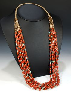 This amazing 10 strand necklace features Italian coral, turquoise and penn shell heishi. It is finished with a squaw wrap closure.