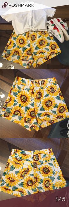 American Apparel high waisted sunflower shorts High waisted and fun sunflower print Denim shorts. Size marked 26/27. Worn once or twice American Apparel Shorts Jean Shorts