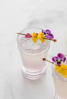 Homemade lemonade spiked with creme de violet liqueur. An chic summer cocktail to try this season!
