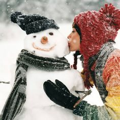 Kissing the snowman. :)
