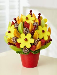 Order Our Sweet and Delicious Fruit Bouquet from Ingallina Box Lunch Los Angeles; our garden of mouthwatering melon & orange wedges, juicy dipped strawberries and sweet pineapple daisies.