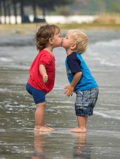 Sweet friendship kiss, worth a thousand words.