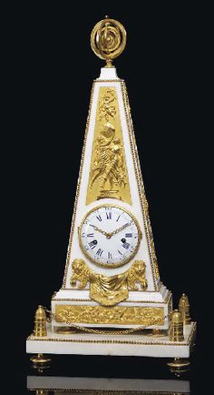 A LOUIS XVI ORMOLU-MOUNTED WHITE MARBLE MANTEL CLOCK CIRCA 1780 The white enamel Roman and Arabic dial with pierced ormolu hands, the movement with twin spring barrels with silk suspended pendulum and countwheel strike on a bell, inset in an obelisk with relief plaque of two draped classical female figures holding aloft the earth on which stands a putto with a burning torch -  27¾ in. (70.5 cm.) high, 13 in. (33 cm.) wide, 9 in. (23 cm.) deep