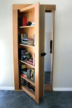 Our secret bookcase door is used by celebrities and royalty worldwide. Fully ass… Our secret bookcase door is used by celebrities and royalty worldwide. Fully assembled and hand-crafted. Hidden Doors In Walls, Hidden Door Bookcase, Hidden Cabinet, Hidden Spaces, Hidden Rooms In Houses, Secret Rooms, Secret Walls, Hidden Storage, Secret Storage