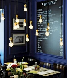 Blue walls, chalkboard sign, & floating bulbs.  Love it