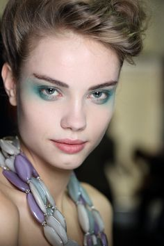 Giorgio Armani 's international make-up artist Linda Cantello was inspired by the floral prints and colours in the collection. She cr...