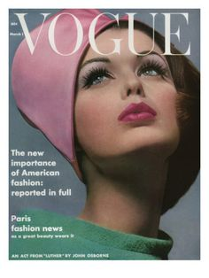 Model Dorothea McGowan wears a bright pink hat and green dress with a loose collar for the cover of the March 1, 1962, Vogue. The fashion photograph was shot by Bert Stern.