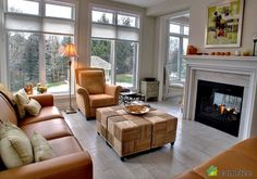 A sunroom that laughs in the face of winter! #sunroom #fireplace