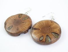 ::WOODEN EARRINGS:: These handcrafted earrings are made from a Banksia seed pod found only in the Southwest corner of Australia. They are truly unique and one of a kind wooden earrings, distinct from anything else you'll find. Each piece has its own individual patterns and features, showing off the Wooden Earrings, Unique Earrings, Boho Earrings, Unique Jewelry, Drop Earrings, Hessian Bags, Australian Gifts, Seed Pods, Gifts For Her