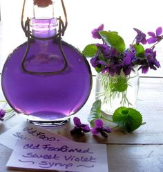 Old Fashioned Sweet Violet Syrup... My Papa Pills use to have these growing in the lawn and flower beds in Sutter Creek. They talked of this syrup... So pretty! If you don't add sugar you could use this to dye your creams, good idea. :)