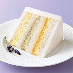 White cake filled with pistachio and apricot buttercreams and iced with buttercream, from Sylvia Weinstock Cakes.