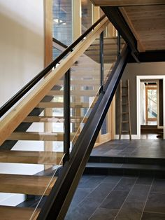 "wood steel and glass stairs - bit too ""industrial"" would loose the wooden handrail. If wood was more ""grey"" and metal matches the extension door detail this could be lovely."