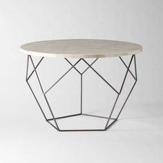 Inspired by Japanese origami, this West Elm coffee table features a natural-bone-tile top supported by a sharp-lined steel-wire base. $479 at West Elm (www.westelm.ca).