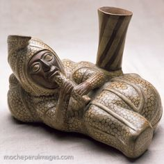 Moche ceramic pot vessel in the form of a recumbent anthropomorphic peanut playing the quena (an Andean flute). (Photo by Nathan Benn, July 1989, from a private collection in Lima, Peru)