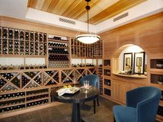 Wine Room    This wine room is beautifully designed and genuinely inviting. Custom cabinetry functions as a classic focal point and smart storage solution.