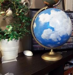 WTF is this? How to ruin a perfectly good globe? Painting clouds over the continents improves it how? At least turn it into Jupiter or something. Globe Projects, Globe Crafts, Map Crafts, Art Projects, Globe Art, Globe Decor, Map Globe, Painted Globe, Vintage Wreath