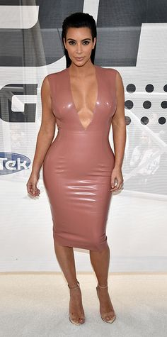 The star donned a skintight pink latex dress and heeled sandals for a Hype Energy event in Nashville.