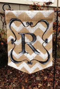 This burlap garden flag fits a standard garden stand. White chevron background with black scroll and monogram. All of the flags are one sided