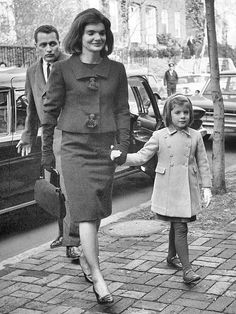 Moving out day in December 1963 - Jackie and her children arrive at their new home in Georgetown.   Clint Hill follows closely behind.