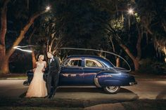 A gorgeous wedding portrait at night with the vintage getaway car! {@richardbell}