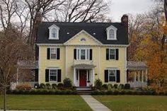 yellow brick house red door. yellow house with turquoise door brick red