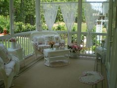 Lovely porch (Love the curtains)