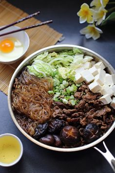 Sukiyaki With Shirataki noodles this dish is a lot lower in calories. I've used stevia in place of sugar and it's just fine. I like a 6 minute boiled soft egg in place of the raw egg dip. Not into the whites texture when raw.Sukiyaki With Shirataki no Asian Recipes, Beef Recipes, Cooking Recipes, Healthy Recipes, Japanese Food Recipes, Hot Pot Recipes, Light Recipes, Healthy Food, Shirataki Noodles