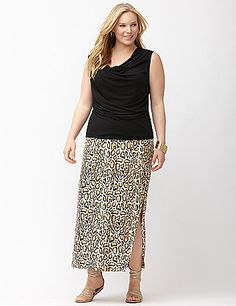 The wardrobe classic maxi skirt takes on the trends in hot animal print and luxe matte Jersey construction for a flattering drape and wash & wear ease. Simply detailed with flattering shirring and a high leg slit, this comfortable pull-on skirt goes anywhere your day takes you and travels like a dream. Elastic waist.<br /> <br /> The Simply Chic Collection - Sleek, easy pieces for every day and everywhere.<br /> lanebryant.com