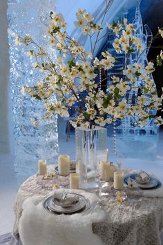 Use of white linens, clear vases, branches, candles - and silks for flowers can make a beautiful winter wedding decorated table