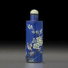An enameled yixing 'magpie and plum flower' snuff bottle 1800-1860 2 3/16in (8.3cm) high 1800-1860年 藍地釉彩喜上梅梢圖鼻煙壺