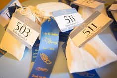 "Our favours came in drawstring bags with ""Race"" ribbons attached to them. #running #wedding #runningwedding"