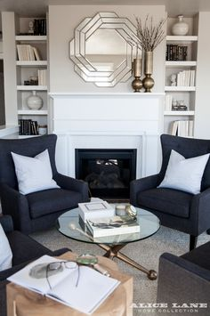 Classic and cozy living room designed by Alice Lane Interior Design. Love that mirror above the mantel Black And Cream Living Room, Cream Living Rooms, Cozy Living Rooms, My Living Room, Living Room Chairs, Living Room Decor, Small Living, Apartment Living, Modern Living
