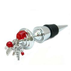 The medical theme bottle stopper is embellished with the caduceus charm, the x-ray charm, the RX charm and colorful beads. This chrome-plated bottle stopper has multiple suction rings for a great seal. Custom Wine Bottles, Rubber Rings, Heavy Rubber, Wine Bottle Stoppers, Top Knot, Plating, Great Gifts, Chrome, Medical