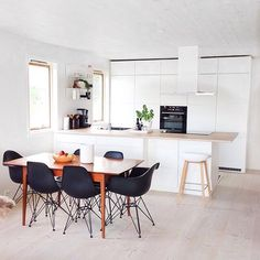 white kitchen with timber and black accents