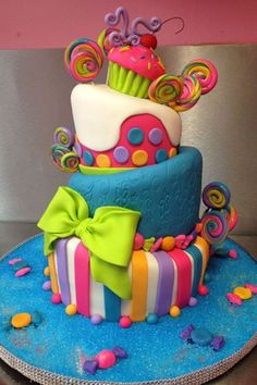 Wicked colourful cake with wonky tiers We've scoured the Web in search cool birthday cake designs and narrowed it down to the top ten birthday cake designs that we could find. Top 10 Birthday Cake Designs Awesome cake………I am going to tell my mom h Cute Cakes, Pretty Cakes, Candy Cakes, Cupcake Cakes, Candy Theme Cake, Candy Themed Party, Bolo Artificial, Backen Baby, Bolo Original