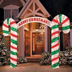 Two SEVEN-FOOT-TALL candy canes that wish you a Merry Christmas! | 17 Insane Decorations For People Who Freaking Love Christmas